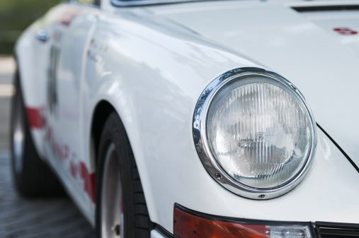 Close-up of the right front headlight of a Porsche 911 Carrera RS 2.7 at the time decrease in Meran / Italy during the South Tyrol classic rally 2015Nahaufnahme des rechten Frontscheinwerfers eines Porsche 911 Carrera RS 2.7 bei der Zeitabnahme in Meran / Italien während der Südtirol Classic Car Rallye 2015